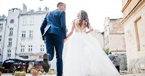 51195135 - running wedding couple, back view